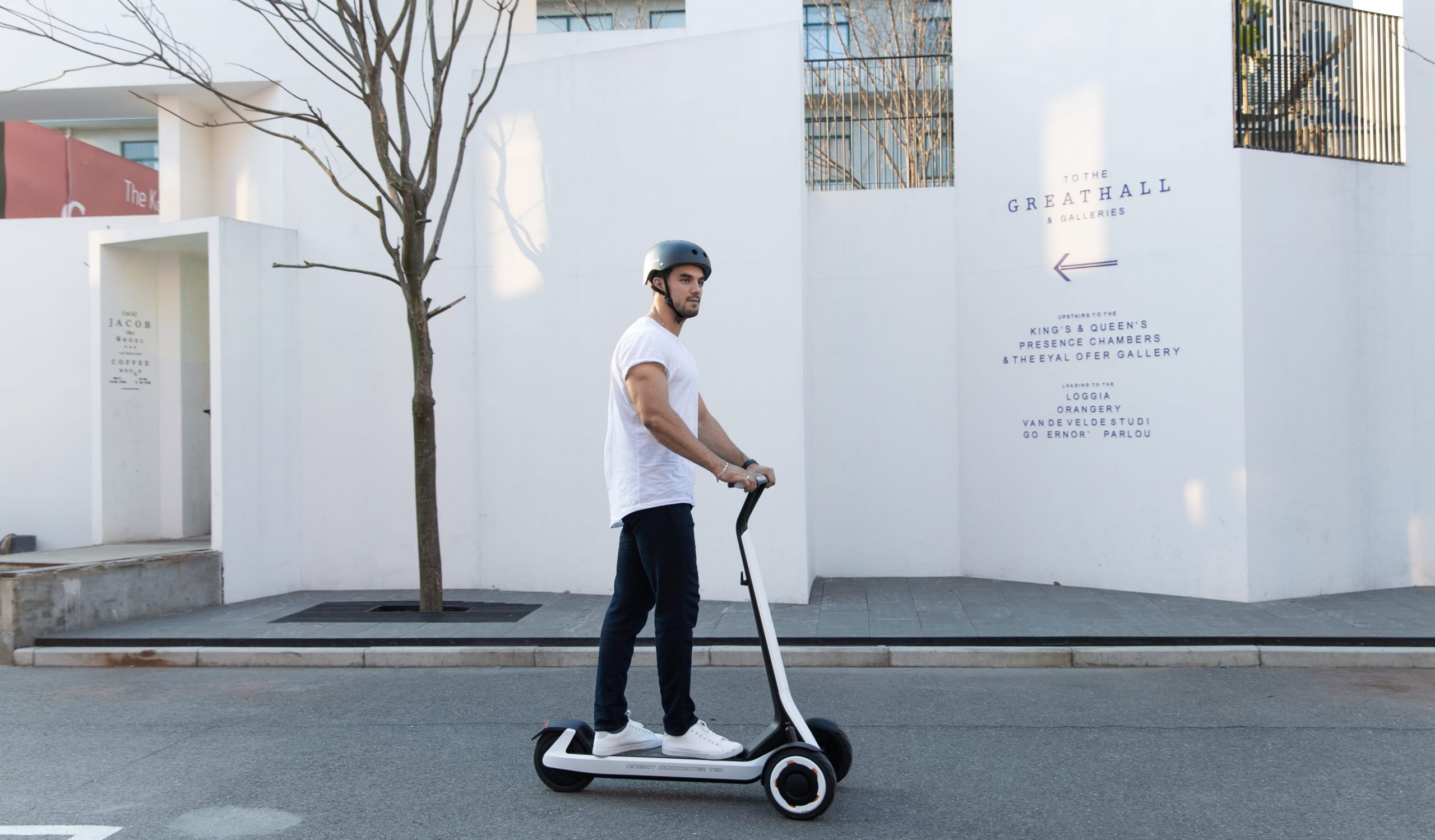 A man riding a Segway electric scooter